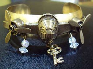 Gold steampunk bracelet with vintage key and propellors